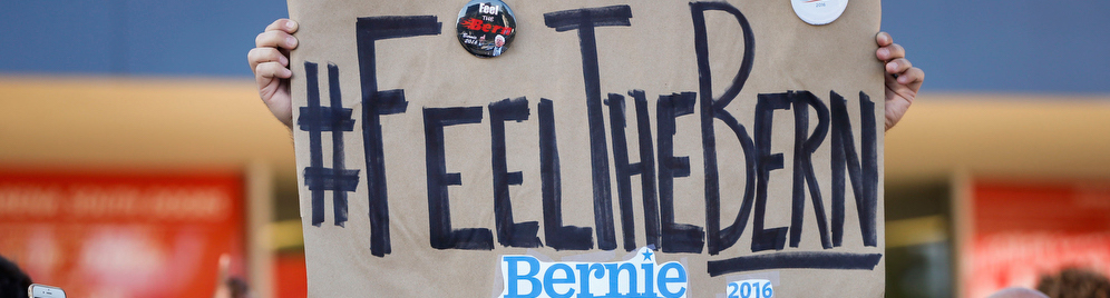 A supporters holds a sign for Democratic presidential candidate Bernie Sanders during campaign event at the LA Memorial Sports Arena in Los Angeles, California, U.S., on Monday, August 10, 2015. Photographer: Patrick T. Fallon/Bloomberg