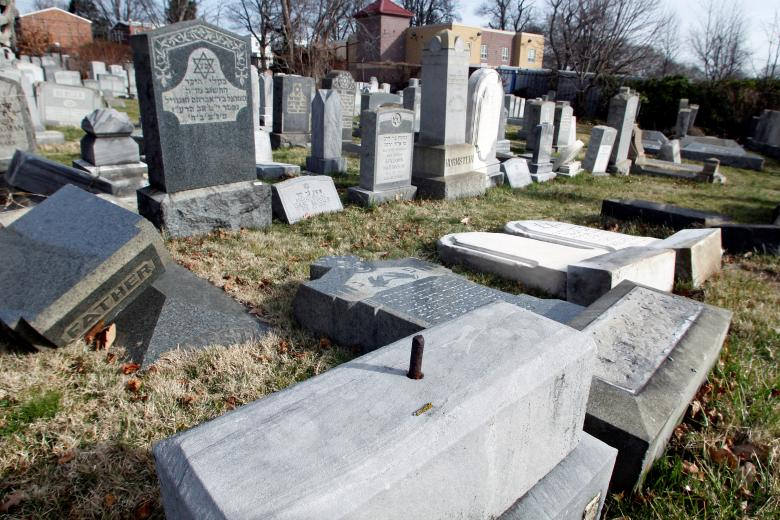 Headstones lay on the ground after vandals pushed them off their bases in the Mount Carmel Cemetery in Philadelphia. REUTERS/Tom Mihalek