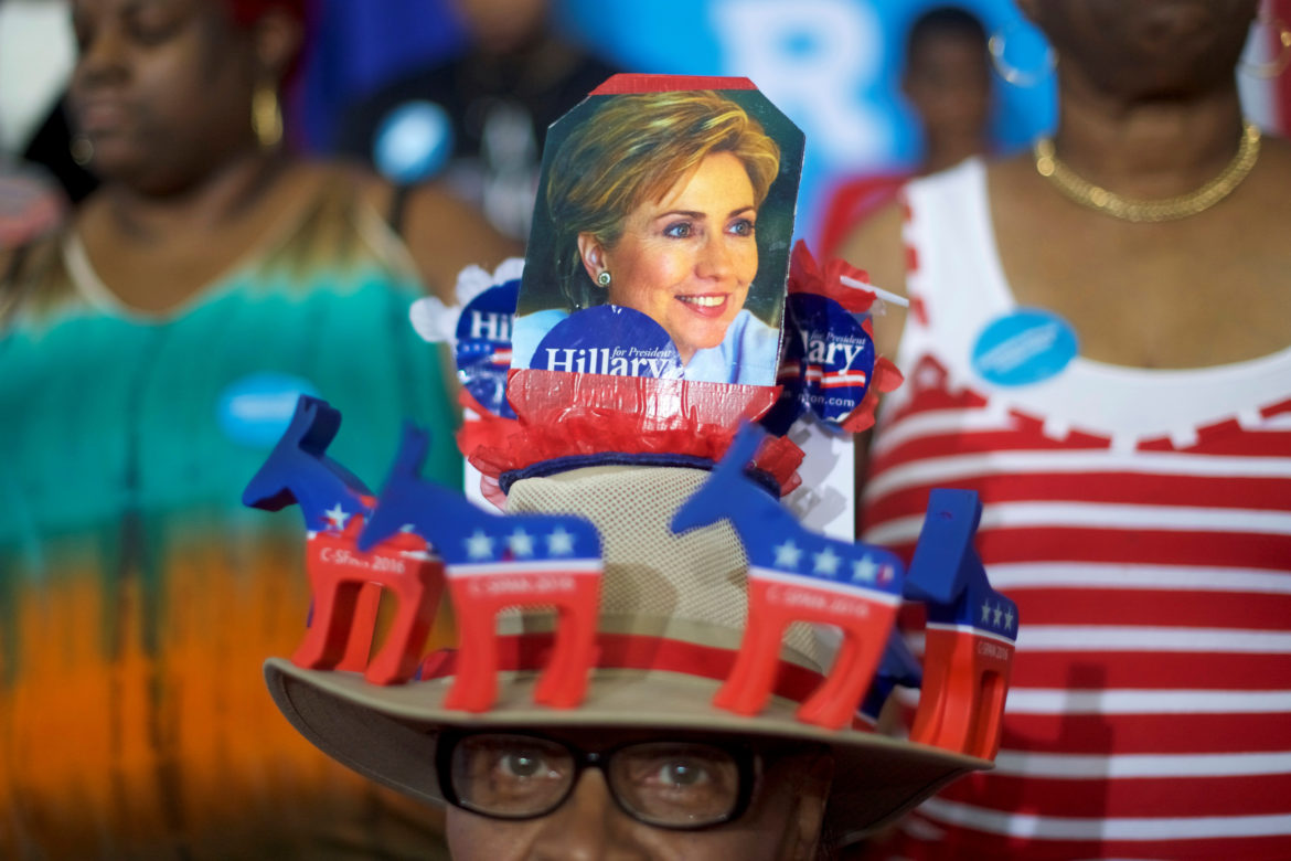 A supporters of Democratic Presidential nominee Hillary Clinton wears a hand made hat before the Democratic Presidential nominee holds a rally at West Philadelphia High School in Philadelphia, Pennsylvania, August 16, 2016.  REUTERS/Mark Makela - RTX2LBV7