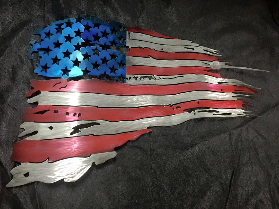 U.S. Flag, metal wall art, tattered from battle.