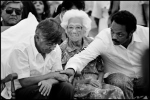 1988. UFW President Cesar Chavez, his mother Juana Estrada Chavez, and Jesse Jackson at the service during which Chavez ended his 36-day hunger strike and Jackson took his up.